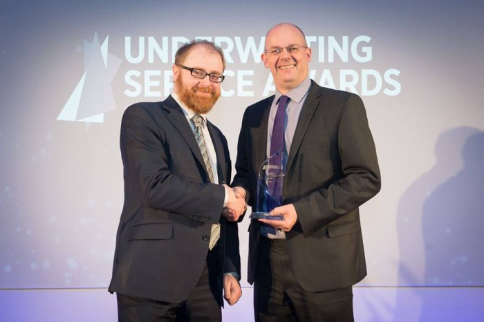 Paul Hiscoe collecting Underwriting Service Award 2015 for Transport and